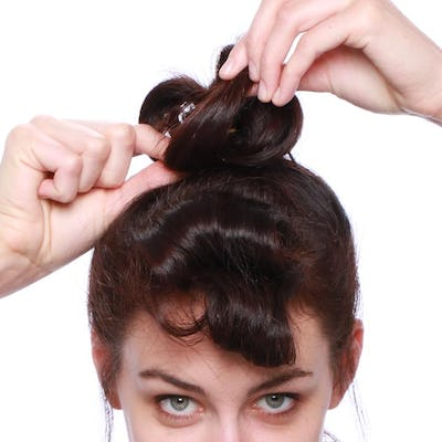 Take the rest of hair and repeat tying at the top of that section