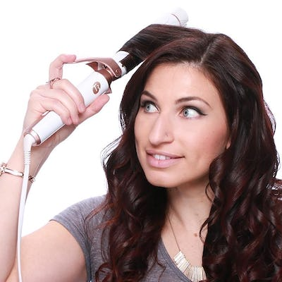 Starting at the front, curl hair in 1-inch sections