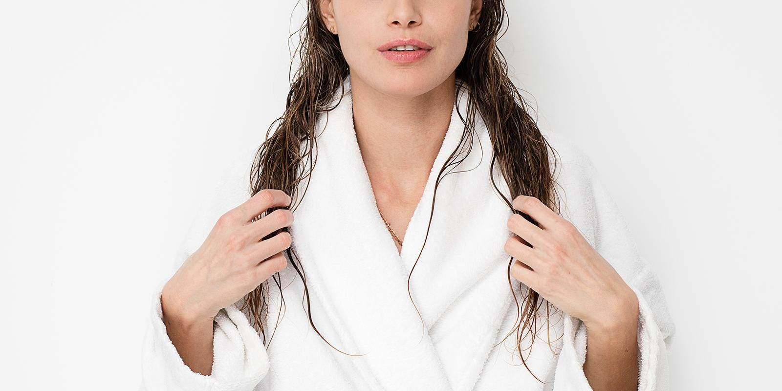 Woman in robe with wet hair