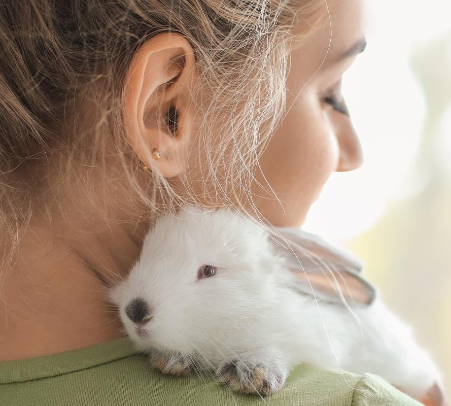 Bunny on woman's shoulder for Madison Reed's Leaping Bunny Certification