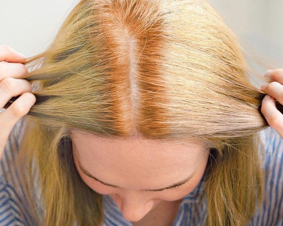 hot roots, orange stripe of hair